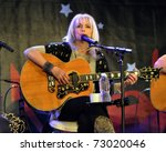 TORONTO, CANADA - MAR 12: Renowned singer/songwriter Emmylou Harris performs at the Songwriter's Circle as part of Canadian Music Week on March 12, 2011 in Toronto, Ontario Canada. - stock photo
