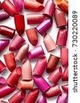 background of broken lipsticks | Shutterstock . vector #730220089