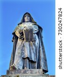 Small photo of Giiordano Bruno Statue Campo de' Fiori Rome Italy. Bruno was heretic burned at stake in Campo de' Fiori. Statue by Ferrari in 1889