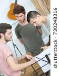 three young male musicians... | Shutterstock . vector #730248316