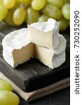 french camembert cheese with ... | Shutterstock . vector #730252090
