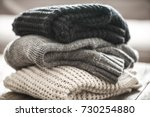 stack of cozy knitted sweaters... | Shutterstock . vector #730254880