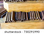 cigars of rolled tobacco leaves ... | Shutterstock . vector #730291990
