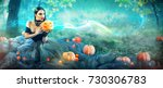 halloween witch with a carved... | Shutterstock . vector #730306783