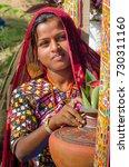 Small photo of KUTCH, GUJARAT, INDIA - 6 NOV. 2014: Young Beautiful Gujarati Kutchi village girl wearing colorful embroidered costume at Rann of Kutch.