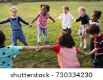 group of diverse kids playing... | Shutterstock . vector #730334230