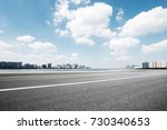 empty asphalt road and... | Shutterstock . vector #730340653