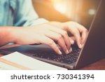 hands typing on laptop in... | Shutterstock . vector #730341394