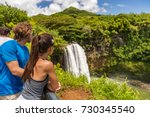 couple tourists at hawaii kauai ... | Shutterstock . vector #730345540
