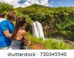 couple tourists at hawaii kauai ... | Shutterstock . vector #730345540