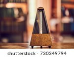 Small photo of Classic metronome in a room with warm tone