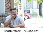 portrait of young latin man... | Shutterstock . vector #730356424