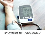 human check blood pressure... | Shutterstock . vector #730380310