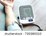 human check blood pressure...   Shutterstock . vector #730380310