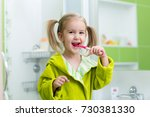 little kid girl brushing teeth... | Shutterstock . vector #730381330
