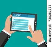 online survey  checklist. hand... | Shutterstock .eps vector #730381336