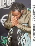 Small photo of Rapper TEE GRIZZLEY attends the 2017 BET HIP-HOP AWARDS red carpet on Friday, October 6th, 2017 at the FILLMORE MIAMI BEACH AT THE JACKIE GLEAN THEATER - USA
