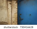 moroccan blue door with stone... | Shutterstock . vector #730416628