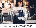 asia woman barista pour milk... | Shutterstock . vector #730423549