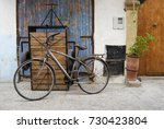 rusty bicycle and wooden two... | Shutterstock . vector #730423804