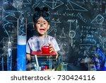 little boy doing experiments in ... | Shutterstock . vector #730424116