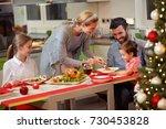 family celebrating christmas  ... | Shutterstock . vector #730453828
