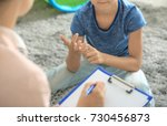 young psychologist working with ... | Shutterstock . vector #730456873