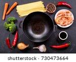 empty wok pan with ingredients... | Shutterstock . vector #730473664