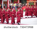 Small photo of KAOHSIUNG, TAIWAN -- SEPTEMBER 28 , 2017: Ceremonial attendants in red robes take up positions for the yearly Confucius Ceremony held on Teachers Day.