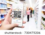 Small photo of Qr code payment , online shopping , cashless technology concept. Retail shop accepted digital pay without money. Hands using mobile phone application to scan code in department store background.