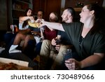friends watching tv at night... | Shutterstock . vector #730489066