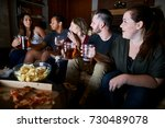 group of friends watching tv at ... | Shutterstock . vector #730489078