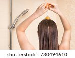attractive woman applying egg... | Shutterstock . vector #730494610