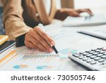 woman with bills and calculator.... | Shutterstock . vector #730505746