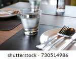 a glass of water on food table...   Shutterstock . vector #730514986