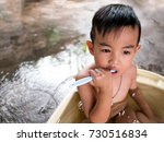 asian baby bathing and playing... | Shutterstock . vector #730516834