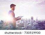 side view of young businessman... | Shutterstock . vector #730519930