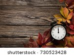 time for autumn concept  close... | Shutterstock . vector #730523428