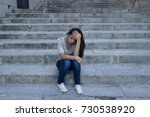 young beautiful and sad... | Shutterstock . vector #730538920