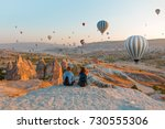 hot air balloon flying over... | Shutterstock . vector #730555306