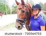 portrait of young  horsewoman... | Shutterstock . vector #730564753