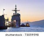 A U.s. Navy Cruiser At Port In...