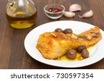 fried cod fish with garlic and... | Shutterstock . vector #730597354