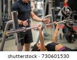 personal trainer and fit woman... | Shutterstock . vector #730601530