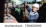 power station worker | Shutterstock . vector #730602040