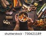 female woman hands holding pan... | Shutterstock . vector #730621189