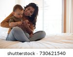 young mother spending time with ... | Shutterstock . vector #730621540