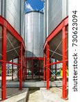 Small photo of Metalware of the silo base for storage of grain crops. Powerful steel supporting beams of red color.