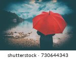 woman with red umbrella... | Shutterstock . vector #730644343