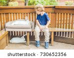 toddler boy caresses and... | Shutterstock . vector #730652356